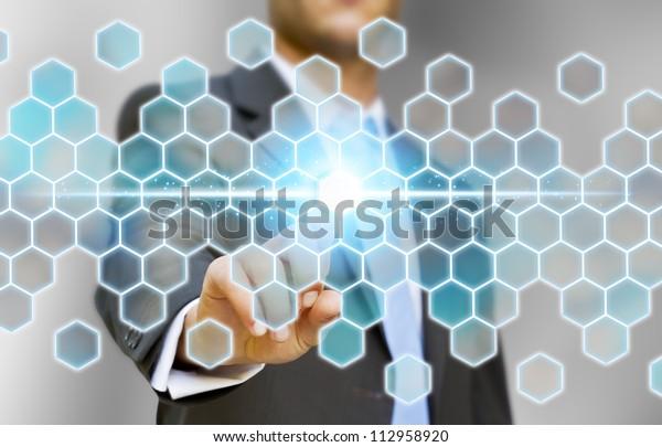 Businessman touching tactile screen