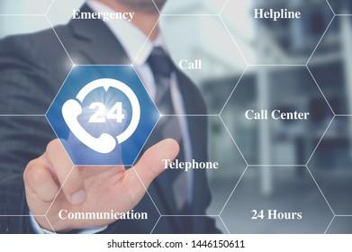 Businessman touching telephone button 24/7