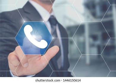 Businessman touching a telephone button
