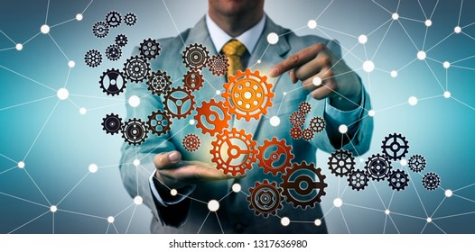 Businessman touching virtual gear in cyberspace. Technology concept for tech support, information engineering, investment, strategy, success, collaboration, connectivity, marketing, managed services.