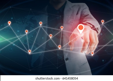 Businessman touching virtual private network on the touch screen world map on screen with connecting light between continents - Shutterstock ID 641458054