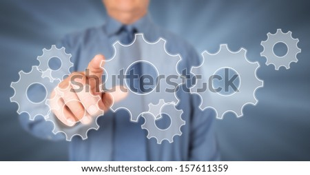 Businessman touching virtual screen. Technology concept background.