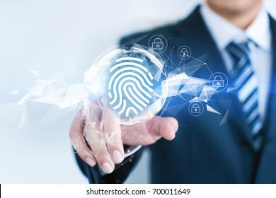A businessman is touching a word with an abstract future background. Compute science, technology, business, internet concept. Fingerprint.