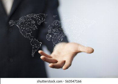 businessman touching a world map on the screen
