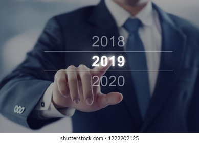 Businessman touching year 2019. Business new year card concept.