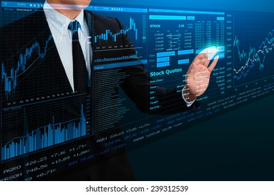 businessman trading stock by futuristic screen interface