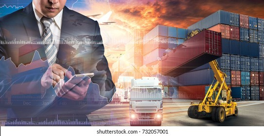 Businessman trading stocks online is pressing button on touch screen interface in front of Container Cargo ship and Cargo plane with Logistic import export and transport industry background