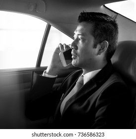 Businessman traveling alone by car