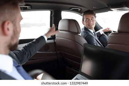 businessman traveling in a luxury ca