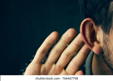 Businessman trying to hear a gossip