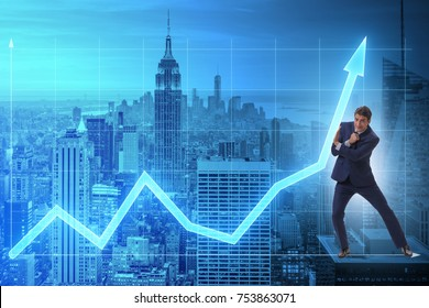 Businessman trying to help economic growth in business concept