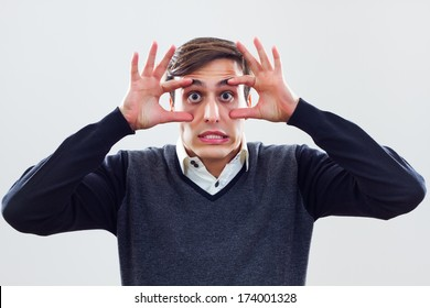Businessman is trying to keep his eyes open in business world,Keep your eyes open!