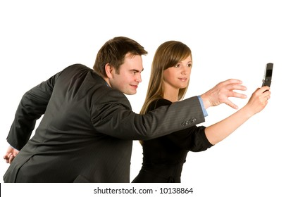 Businessman trying to take phone from woman on white