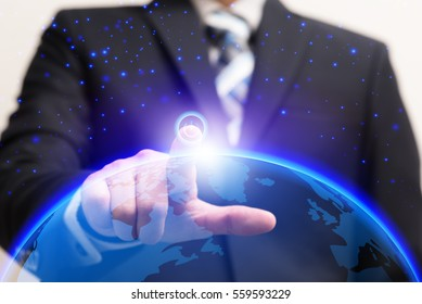 Businessman turn on power switch to connect global connection with digital planet, Future technologies conceptual, IOT internet of things concept
