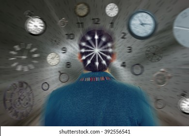 Businessman turned to camera. Rear back view of business man standing in front of passing time.Fast time concept. Race with time.Too little time.