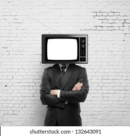 businessman with tv head on a brick wall background