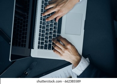 Businessman typing on keyboard, businessman working, businessman behind laptop.