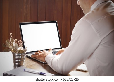 Businessman typing on laptop with empty screen for your text. Stock Photo