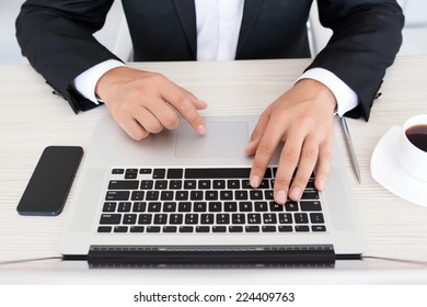 Businessman typing on laptop in office