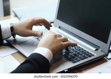 businessman typing on laptop.people and technology
