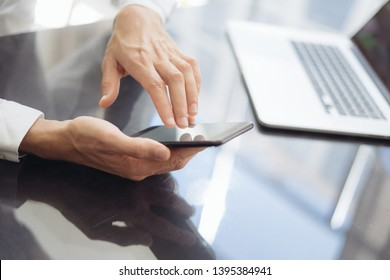 Businessman typing on smartphone screen, chatting in social networks, meeting website, searching internet, sending sms, using text messenger or online banking. Close up of male hands