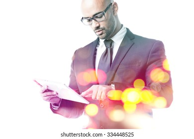Businessman typing on a touch pad double exposure isolated on white
