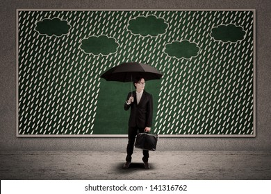 Businessman and umbrella with copy space under the rain
