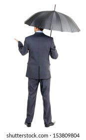 Businessman with umbrella, isolated on white