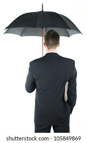 Businessman with an umbrella and a newspaper