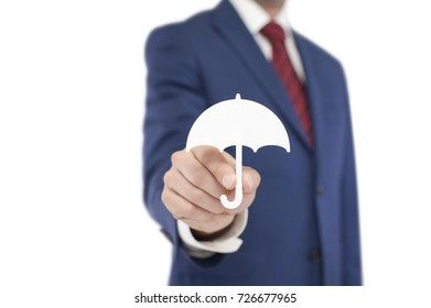 Businessman with umbrella shape isolated on white background. Clipping path included.