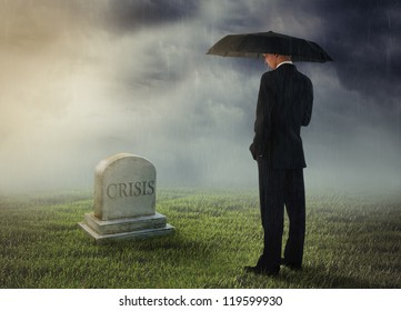 Businessman with umbrella standing near tomb of crisis