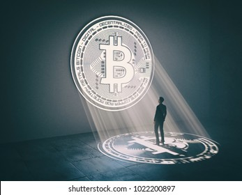 Businessman under bitcoin light. Cryptocurrency concept. Financial concept Virtual money