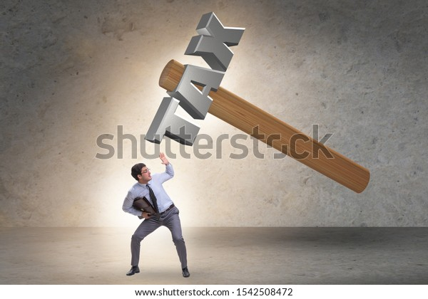 Businessman under the burden of tax payments