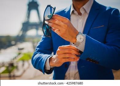 Businessman under the Eiffel Tower in Paris, France