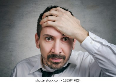 Businessman under stress after realized that he made a mistake