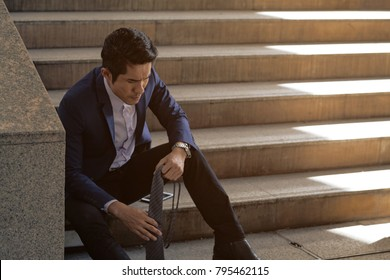 Businessman Unemployed Sitting Sad and Sad.No hope of Stress, Work Stress. Unemployed concept