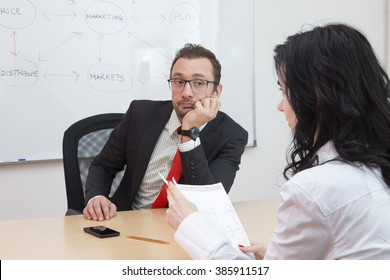Businessman unhappy with the ideas of his female coworker