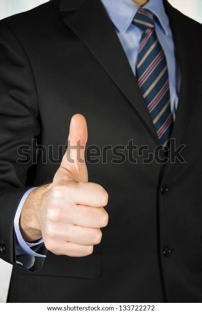 "Businessman ""up sign"""