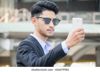 Businessman Use Cell Phone to Shoot