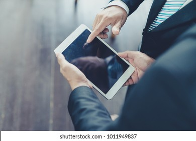 Businessman use computer tablet for work in communication around worldwide to success marketing plan of company