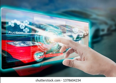 Businessman use fingers touch to screen interface website car auction,to bid second hand cars online via internet system,concept online shopping convenience trading,car auctions internet of customers.