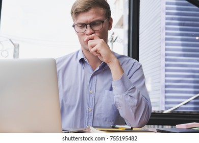 businessman use laptop with business plan at workplace. young man work with computer at office. finance market analyst analyze financial data.