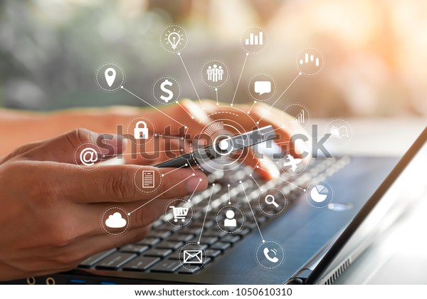 Businessman use laptop and smartphone with IOT, internet of things conceptual sign, internet era, internet in everyday lives.