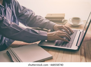 Businessman use laptop and smartphone for routine working on wood office table. Business concept.