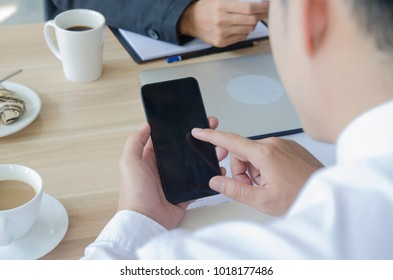 Businessman use mobile phone screen blank in co working space or coffee shop