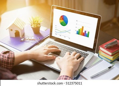 businessman use on-line via laptop computer for analyzing financial chart,writing business plan,open net-book,phone,tablets,Accountants work reports,morning light,vintage color