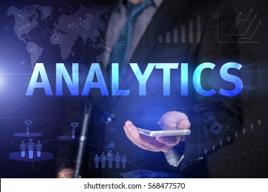 Businessman Use Smartphone And Selecting Analytics, Touch Screen. Virtual Icon. Graphs Interface. Business concept. Internet concept. Digital Interfaces