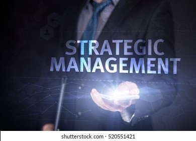 Businessman Use Smartphone And Selecting Strategic Management, Touch Screen. Virtual Icon. Graphs Interface. Business concept. Internet concept. Digital Interfaces