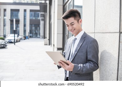 Businessman use tablet at outdoor