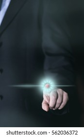 Businessman uses Touchscreen with his finger, glowing icon